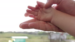 Child's hand and the man in the sun Stock Footage