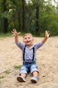 Boy sitting on the sand Stock Photos