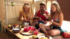 Group of young friends enjoying meal on tree house Stock Footage