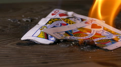 Burning poker card king and queen of hearts Stock Footage
