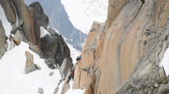 Rock climbing in the rock of Mont Blanc massif. Chamonix, France, Europe - stock footage