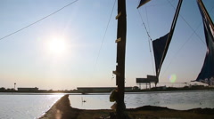 Wind energy windmill at sunset Stock Footage