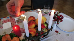 Tableware. On the festive table fruit, red fish, a glass of wine and a candle Stock Footage