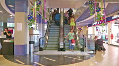 Escalator at the mall. Buyers are going up Stock Footage