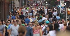 Crowd of commuter people walking street sidewalk timelapse Stock Footage