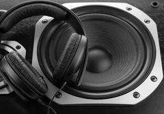Headphones on stereo speakers Stock Photos