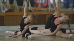 Young artistic gymnast training in the gym Stock Footage