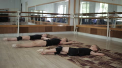 Three girls gymnasts warming up on the floor in the gym Stock Footage