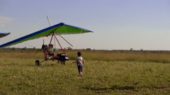 A boy going to an ultralight trike Stock Footage