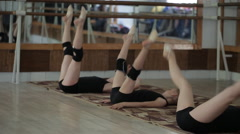Young girls are trained in the gym. The exercises in rhythmic gymnastics Stock Footage