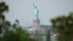 Statue Of Liberty Between Two Trees Stock Footage