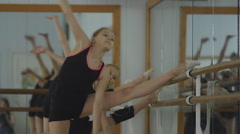 Artistic gymnasts warming up at the mirror. Workout in the gym. Rhythmic Stock Footage