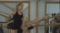 artistic gymnasts warming up at the mirror. Workout in the gym. Rhythmic - stock footage