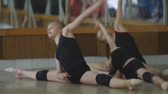Young girls warm up in the gym. The exercises in rhythmic gymnastics Stock Footage
