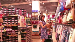Women and girls in the store make a purchase Stock Footage
