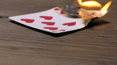Burning  seven of hearts  poker card Stock Footage