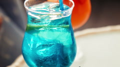 Close up on blue beverage with fruit slice Stock Footage
