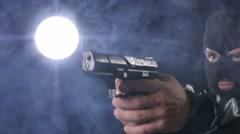 Masked criminal holding gun Stock Footage