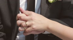 The couple hold each other's hands. Hand-in-hand wedding Stock Footage