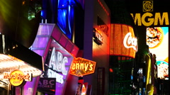 Zoom Out - Colorful Neon Advertising Lights at Night - Las Vegas Stock Footage