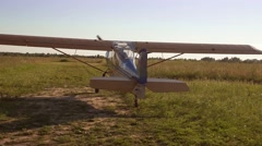 An old airplane riding on green grass Stock Footage