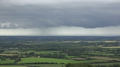 View towards a rain storm passing over the Irish countryside, Co Wexford. Stock Footage
