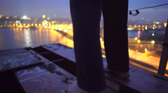 Depression, lonely barefoot male standing on top of bridge, suicidal thoughts Stock Footage