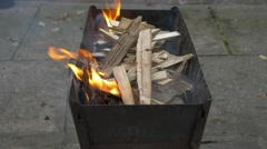 Burning wood and coal in the brazier. Preparing barbecue shish kebab and grill - stock footage