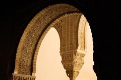 Decorated arcs of Alhambra palace Stock Photos