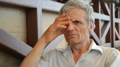 elderly man serious think, reflects - stock footage