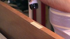 Master makes doors - stain toning Stock Footage