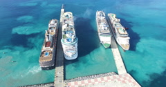 Aerial view of four cruise docking Stock Footage