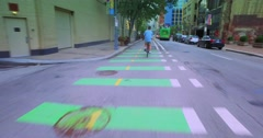 Following a Biker in a Bicycle Lane Penn Avenue in Pittsburgh Stock Footage