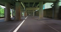 Fast Blurred Motion Driving Through Cement Parking Structure in City - stock footage