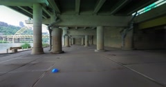 Perspective of Driving Under City Through Cement Structure Stock Footage