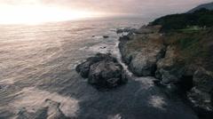 4k aerial along waves splashing rocks Stock Footage