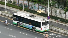 WUHAN, CHINA  electric trolley bus stops in bus lane & hooks up to power Stock Footage