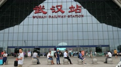 WUHAN, CHINA, high speed railway station entrance with people Stock Footage