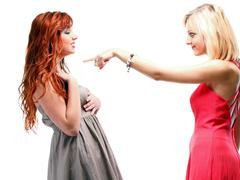Two pretty women ginger with blonde in gowns on white Stock Photos