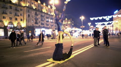Young couple making dangerous tricks in public place, acro yoga performance Stock Footage