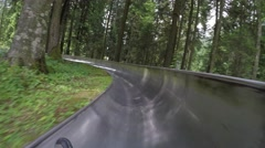 Downhill with summer bobsleigh. Spiazzi di Gromo. Orobie area. Italy. Stock Footage