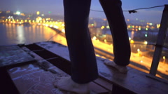 Barefoot man standing on bridge edge, thinking about suicide, changing his mind Stock Footage