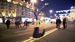 Pair of professional athletes doing acrobatic yoga on the street, timelapse Stock Footage