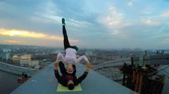 Professional skills, athletes doing dangerous stunts on bridge, acrobatic yoga Stock Footage