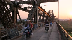 Motorbikes, trains and pedestrians cross an old bridge, Hanoi, Vietnam Stock Footage