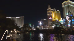 Famous hotel building in Las Vegas tourism attraction by night traffic street US Stock Footage
