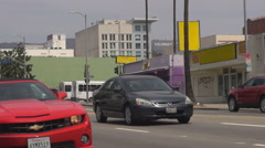 Hollywood sign on mountain hill traffic car on busy avenue in Los Angeles area  Stock Footage