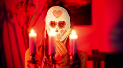 Masquerade hold mask candle Stock Footage