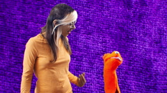 Purple puppet with alternative woman girl Stock Footage