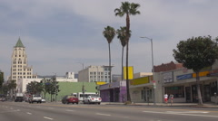 Busy large avenue in Los Angeles Hollywood sign tourism attraction car pollution Stock Footage